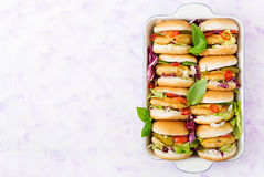 Mini hamburgers with chicken burger, cheese and a vegetables Stock Photo