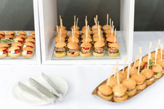 Mini hamburgers, finger food, mini burgers, party food, sliders. Stock Photos