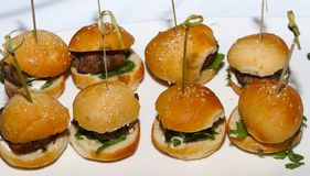 Sliders with mini buns and toothpicks stock image