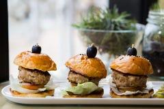 Mini hamburguesas, cerdo Imagen de archivo libre de regalías