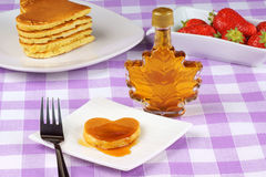 Mini heart-shaped pancake with syrup Royalty Free Stock Photos