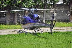 Mini helicopter. Helicopter departing from a football stadium Royalty Free Stock Photo