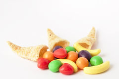 Mini Horn of Plenty Trio. A trio of cornucopia shaped chips with  pieces of fruit candy Stock Photo