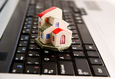 Mini house on laptop keyboard Royalty Free Stock Photography