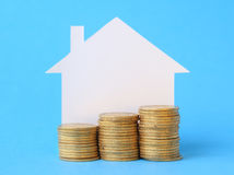 Mini house with money Stock Photo