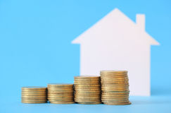 Mini house with money Stock Photos