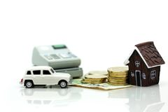 Mini House with stack of coins and car,Saving and investing mone. Y concept, Future financial planning concept Stock Images