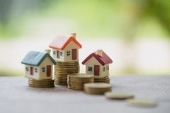 Mini house on stack of coins, Real estate investment, Save money. With stack coin, Business growth investment and financial, Mortgage concept stock image
