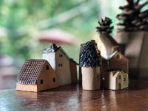 Cute Mini houses made by ceramic on the wooden table , Decorative for your house stock images