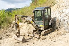 Mini hydraulic excavator. Being used in a salt extraction plant stock photo