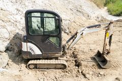 Mini hydraulic excavator. Being used in a salt extraction plant royalty free stock photography