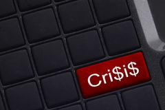 Mini keyboard with button saying Crisis Stock Photo
