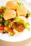 Mini kippenburgers Stock Afbeeldingen