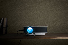 Mini led projector on wood table in a room projector home theate. R concept Stock Image