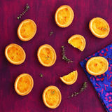 Mini lemon tarts with thyme on deep lilac background Royalty Free Stock Images