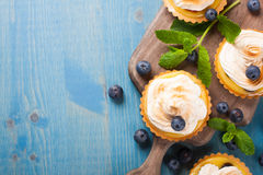 Mini lime curd tartlets with meringue. Royalty Free Stock Photo