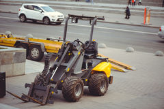 Mini loader cleaning city Royalty Free Stock Photography