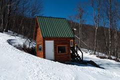 Log cabin in snow Stock Photos