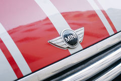 Mini logo on car. BERLIN, GERMANY - MAY 11, 2017: Close up to trademark logo on red Mini car parked near Kurfürstendamm in Berlin Charlottenburg Royalty Free Stock Photos