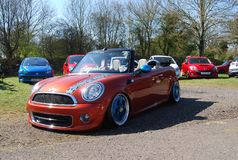 Mini lowered. Mini modified air suspension alloys royalty free stock photography