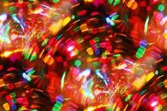 Mini luces brillantes a través del vidrio de vino Fotografía de archivo