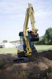 Mini-máquina escavadora Foto de Stock Royalty Free