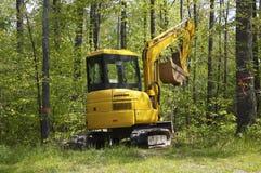 Mini máquina escavadora Imagem de Stock Royalty Free