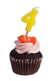 Mini magdalena con la vela del cumpleaños Imágenes de archivo libres de regalías