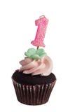 Mini magdalena con la vela del cumpleaños para un año imágenes de archivo libres de regalías