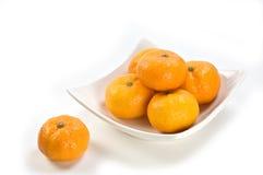 Mini Mandarin Oranges. On white dish with white background Stock Photos