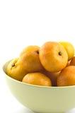 Mini mandarin oranges. In pale green bowl on white background Royalty Free Stock Image