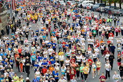 Mini Marathon runners. RIGA, LATVIA, MAY 17, 2009: Mini Marathon runners start the Riga International Marathon on May 17, 2009 Royalty Free Stock Images
