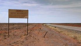 Mini Market 300km ahead road sign Royalty Free Stock Photography