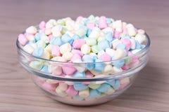 Mini marshmallows in glass bowl on wooden table Stock Photos