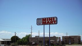 Mini mart shop sign. At freeway in desert stock video footage