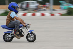 Mini motorbike. Young boy speeding on a mini motorbike Royalty Free Stock Images