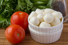 Mini mozzarella in ceramic cup. With tomato, lettuce and pepper Royalty Free Stock Photography