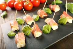 Mini mozzarella wrapped in prosciutto ham and baked Royalty Free Stock Image