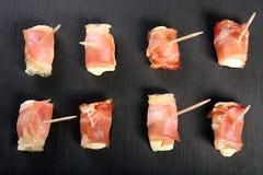 Mini mozzarella wrapped in schwarzwald ham and baked Royalty Free Stock Photo