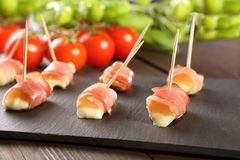 Mini mozzarella wrapped in schwarzwald ham and baked.  stock photos