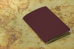 Mini notebook on a old world map. A mini notebook on a old world map stock photos