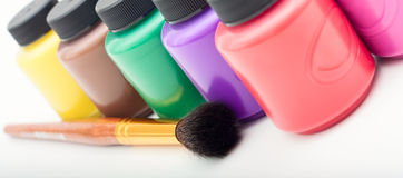 Mini paint cans and brush Royalty Free Stock Photo