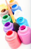 Mini paint cans and brush Stock Images