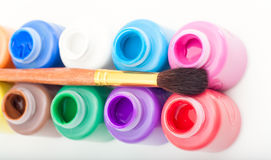 Mini paint cans and brush Stock Photo