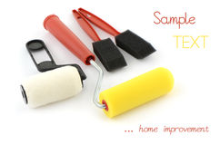 Mini paint rollers and sponges. For home improvement projects on white background with space for text Royalty Free Stock Images