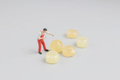 Mini of painters of workers with candy Stock Images