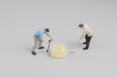 Mini of painters of workers with candy Royalty Free Stock Photos