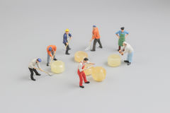 Mini of painters of workers with candy Stock Photos