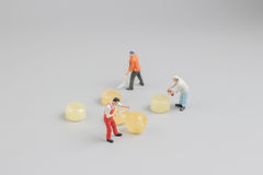 Mini of painters of workers with candy Royalty Free Stock Image