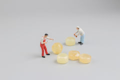 Mini of painters of workers with candy Royalty Free Stock Photography